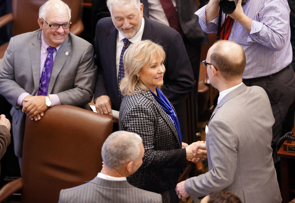 Photo - Gov. Mary Fallin shakes hands with Rep. Scott Inman, House Minority Leader, after  the Oklahoma Legislature's 2016 State-of-the-State Address by Gov. Mary Fallin in the chamber of the House of Representatives at the Oklahoma state capitol on Monday, Feb. 1, 2016, in Oklahoma City, Okla. Photo by Jim Beckel, The Oklahoman