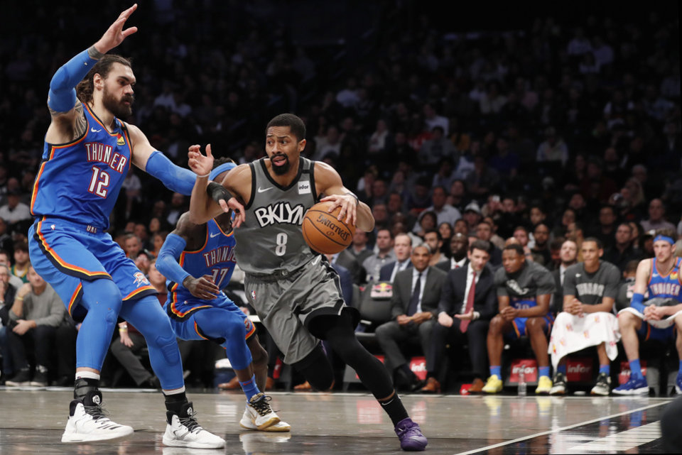 Photo - Oklahoma City Thunder center Steven Adams (12) defends as Brooklyn Nets guard Spencer Dinwiddie (8) drives to the basket during the second half of an NBA basketball game, Tuesday, Jan. 7, 2020, in New York. The Thunder defeated the Nets 111-103 in overtime. (AP Photo/Kathy Willens)