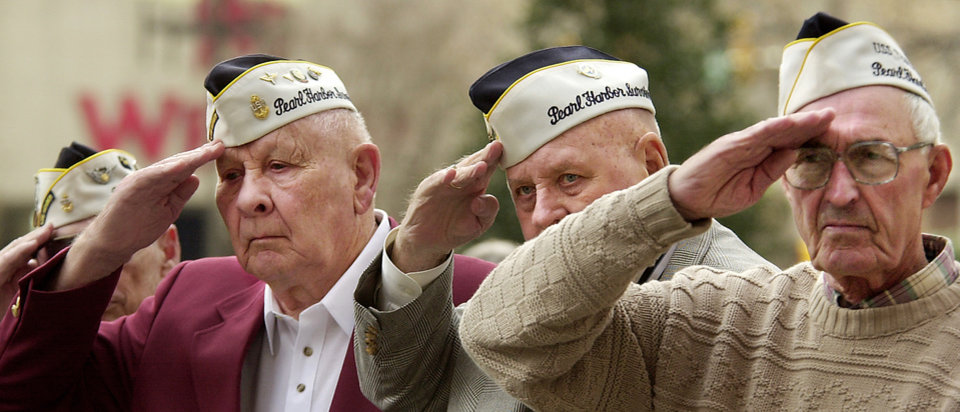 Photo - Bud Gilbert, far left, remembers Pearl Harbor on the 2001 anniversary.