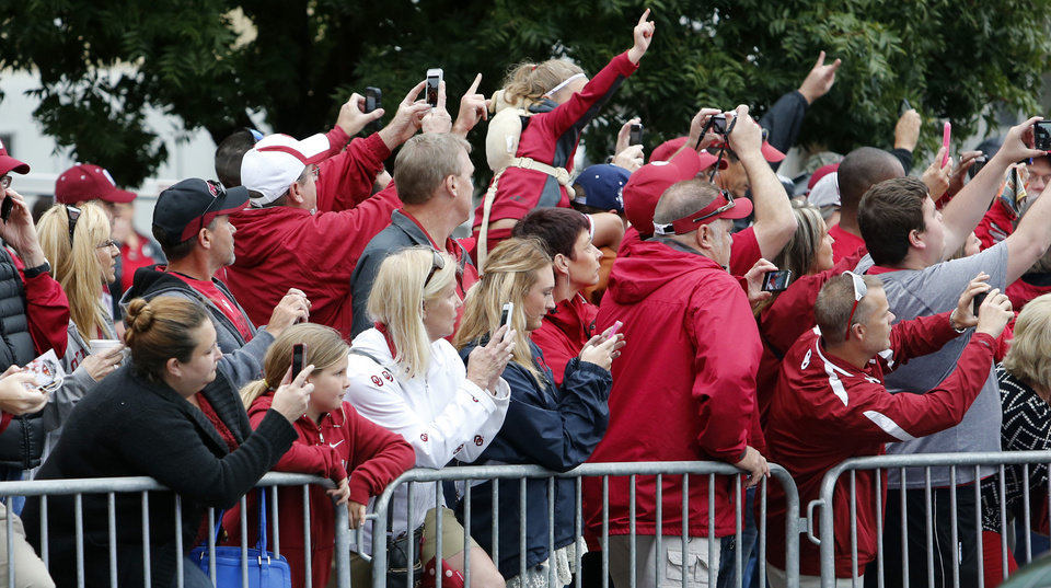 Photo - Fans line the route as the Sooners arrive for the Red River Showdown college football game between the University of Oklahoma Sooners (OU) and the University of Texas Longhorns (UT) at the Cottonbowl in Dallas, Texas on Saturday, Oct. 11, 2014. 
