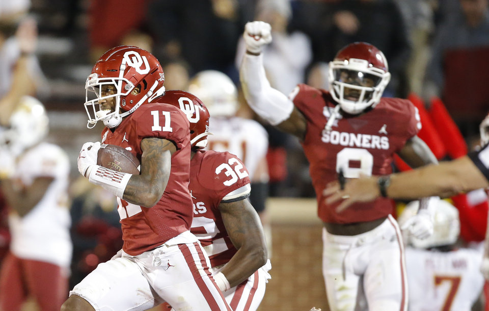 Photo - Oklahoma's Parnell Motley (11) celebrates after an interception during an NCAA football game between the University of Oklahoma Sooners (OU) and the Iowa State University Cyclones at Gaylord Family-Oklahoma Memorial Stadium in Norman, Okla., Saturday, Nov. 9, 2019. [Bryan Terry/The Oklahoman]