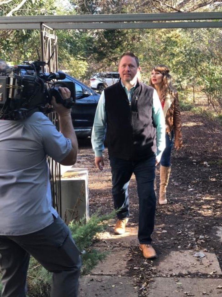 Photo -  Camera operator Chris McCaffrey records Oklahoma City real estate agents Troy and Denise Schroeder for their third appearance on HGTV's