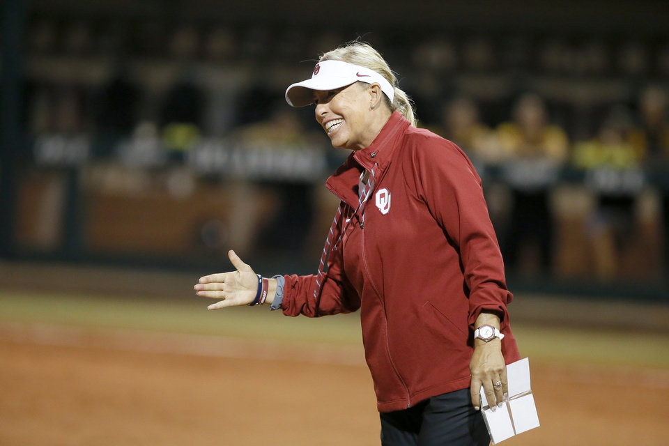 Photo - Oklahoma coach Patty Gasso smiles after an OU home run during the Norman Regional NCAA softball tournament game between the University of Oklahoma (OU) and UMBC in Norman, Okla., Friday, May 17, 2019. Oklahoma won 12-0.  [Bryan Terry/The Oklahoman]