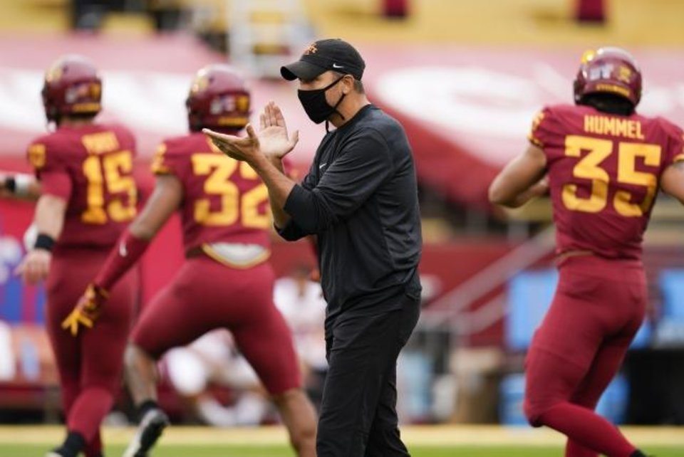 Photo -  Iowa State coach Matt Campbell claps on his team in pregame warmups before a 31-14 loss to Louisiana-Lafayette on Sept. 12 in Ames, Iowa. [AP Photo/Charlie Neibergall]