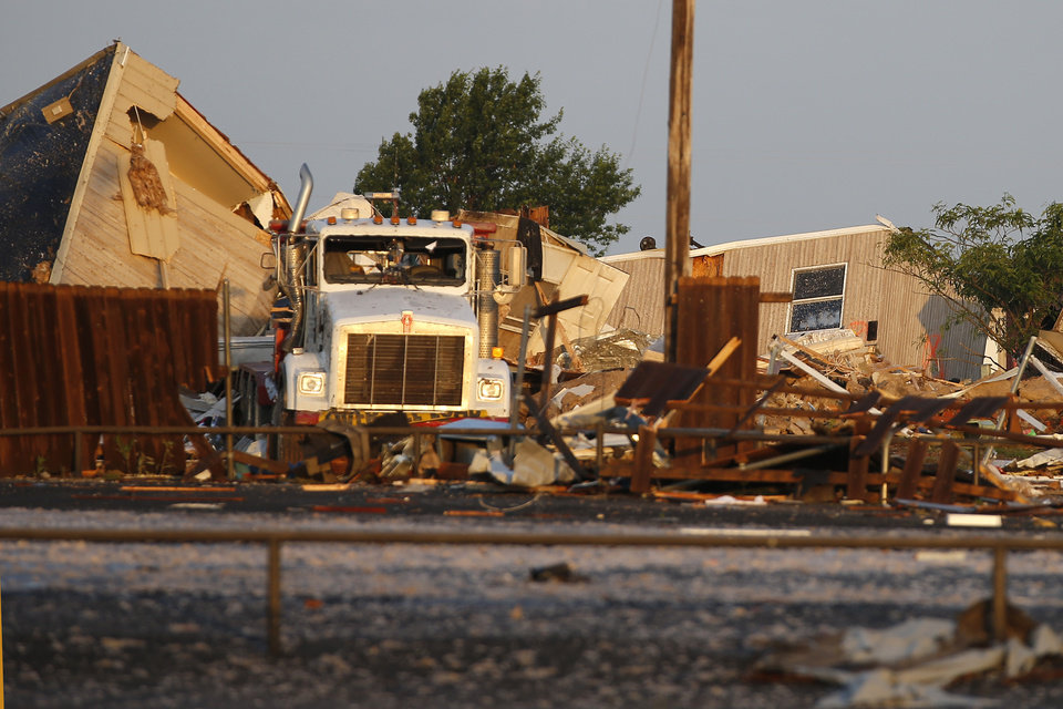 Photo - Tornado damage to mobile homes near the American Budget Value Inn in El Reno, Okla., Sunday, May 26, 2019. [Bryan Terry/The Oklahoman]