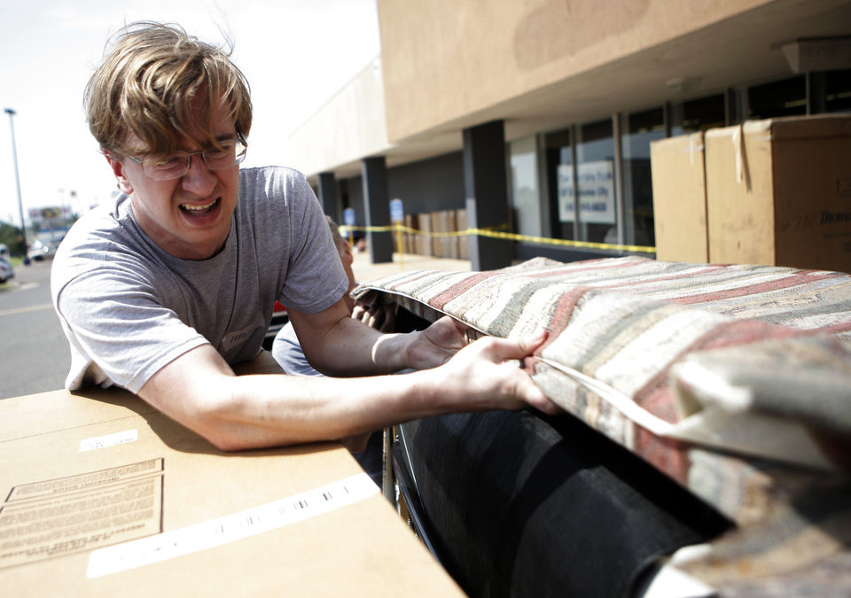 ... Photo   Alex Dooley Of The First Baptist Church Of Oklahoma City Loads  A Sofa To