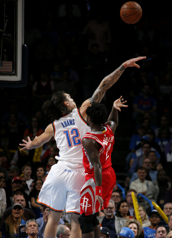Photo - Oklahoma City's Steven Adams (12) blocks the shot of Houston's Patrick Beverley (2) during an NBA basketball game between the Oklahoma City Thunder and the Houston Rockets at Chesapeake Energy Arena in Oklahoma City, Friday, Jan. 29, 2016. Photo by Bryan Terry, The Oklahoman