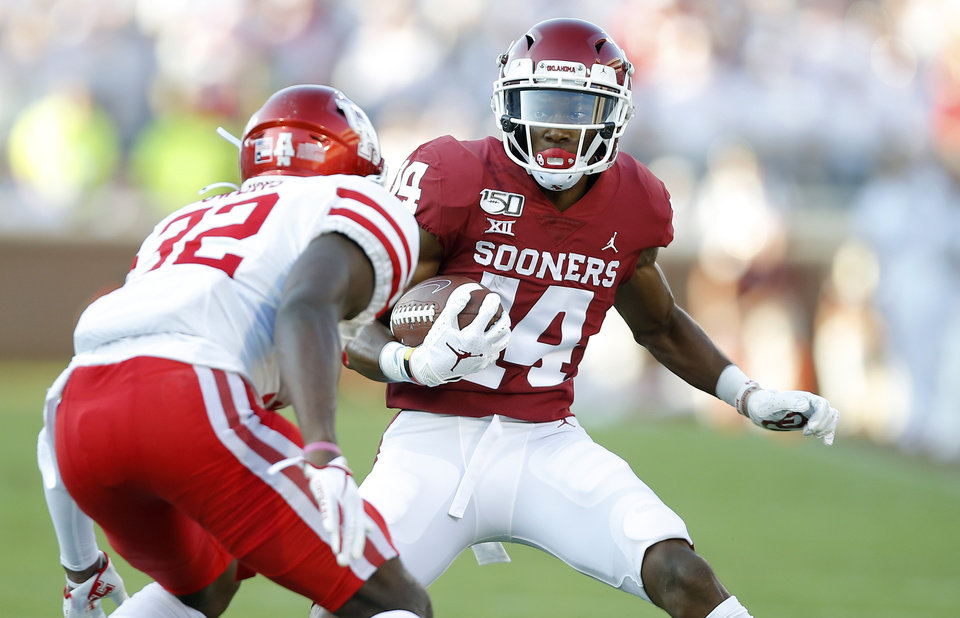 Photo - Oklahoma's Charleston Rambo (14) carries the ball after a reception during a college football game between the University of Oklahoma Sooners (OU) and the Houston Cougars at Gaylord Family-Oklahoma Memorial Stadium in Norman, Okla., Sunday, Sept. 1, 2019. Oklahoma won 49-31. [Bryan Terry/The Oklahoman]