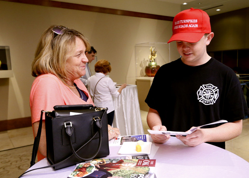 Photo - Jill Strother and son Jake, 15, attend a forum for Republican candidates for governor at the Oklahoma City Museum of Art on Monday, April 23, 2018 in Oklahoma City, Okla.  Photo by Steve Sisney, The Oklahoman