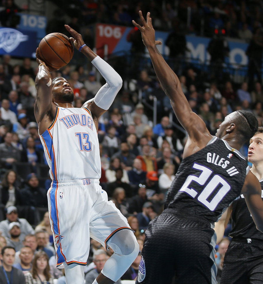 Photo - Oklahoma City's Paul George (13) shoots over Sacramento's Harry Giles (20) during an NBA basketball game between the Oklahoma City Thunder and the Sacramento Kings at Chesapeake Energy Arena in Oklahoma CIty, Saturday, Feb. 23, 2019. Photo by Bryan Terry, The Oklahoman