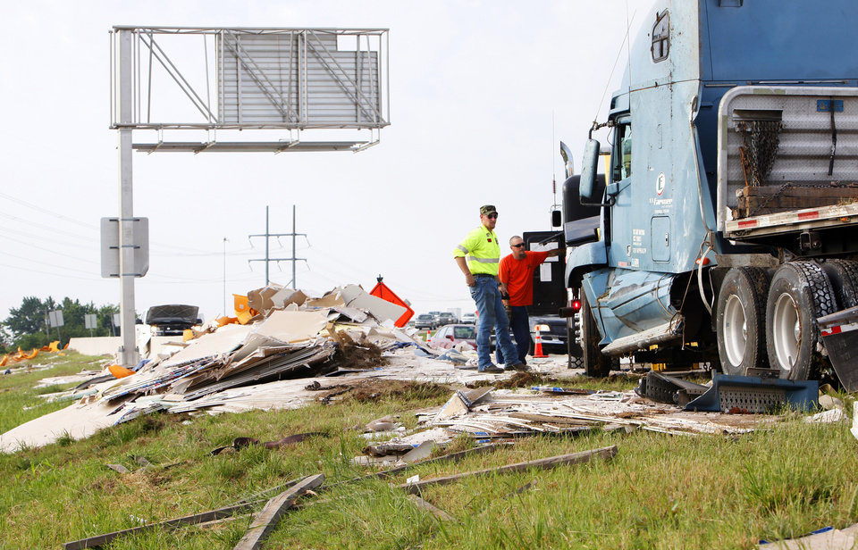 Photo -  A tractor-trailer hauling drywall wrecked on the off-ramp from eastbound I-44 onto SW 59 Street in Oklahoma City in May, 2010. The Oklahoma Department of Transportation spends about $5 million a year removing debris and litter from the state's roadways. [The Oklahoman Archives]