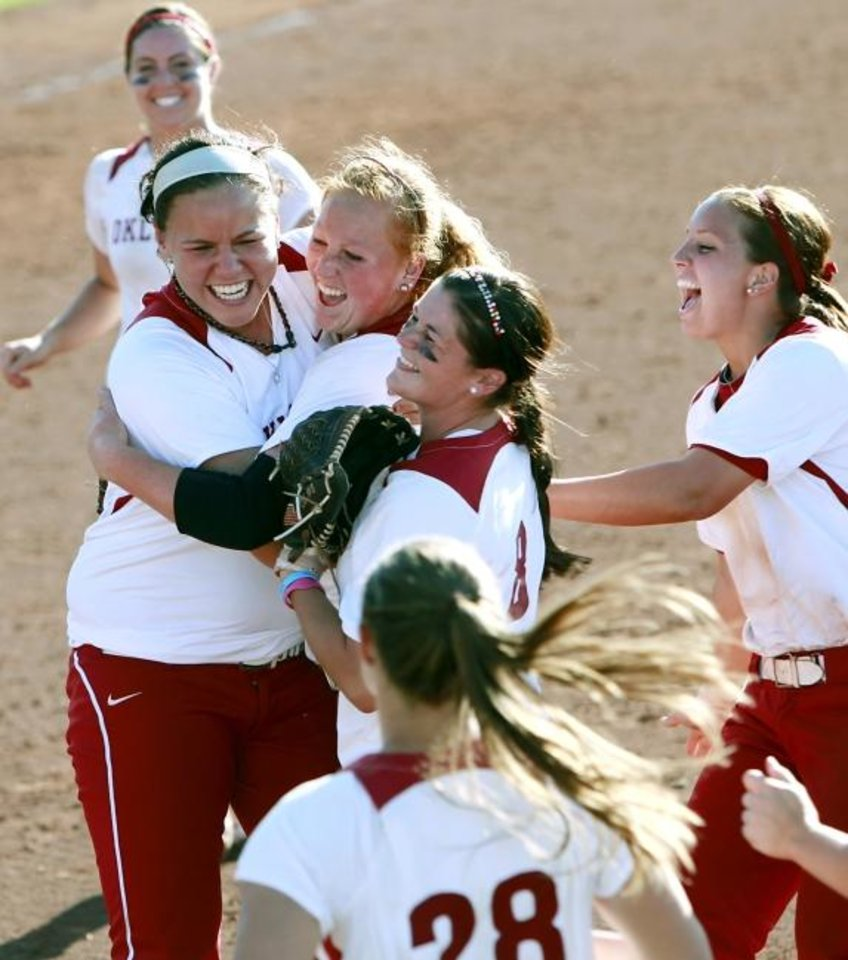 Photo -  Oklahoma pitchers Michelle Gascoigne and Keilani Ricketts, at left, celebrate with teammates  during an NCAA Softball Regional in 2011. Both former OU stars are now coaching -- Ricketts at OU and Gascoigne at Northwestern. [OKLAHOMAN ARCHIVES]