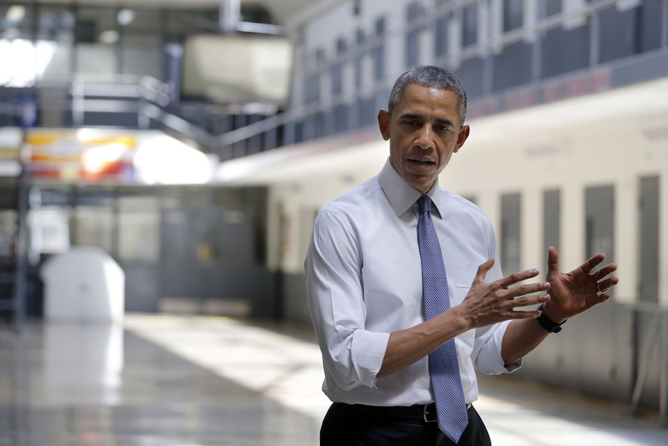 Photo - President Barack Obama speaks to the media following a tours the El Reno Federal Correctional Institution in El Reno, Okla., Thursday, July 16, 2015. Photo by Sarah Phipps, The Oklahoman