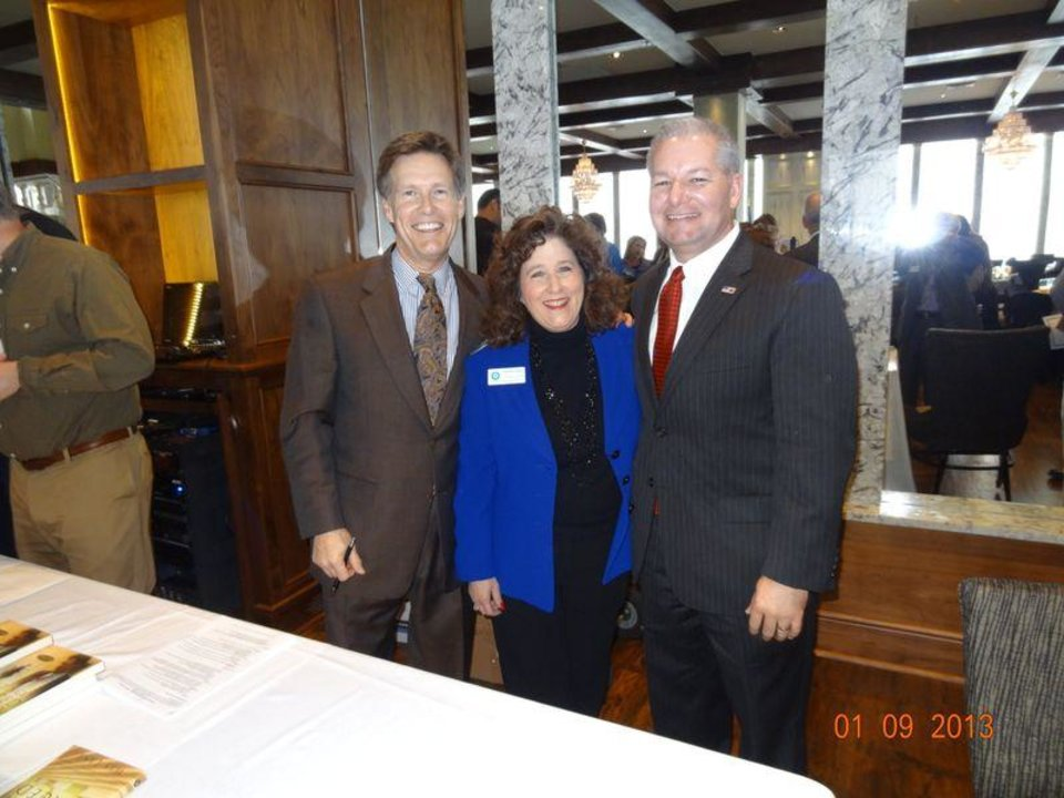 Photo -  Among the most memorable OK Ethics programs for founder Shannon Warren, center, is when Oklahoma County District Attorney David Prater, right, publicly reconciled with former DA Wes Lane, left, seven years after their hostile campaign. [PHOTO PROVIDED]