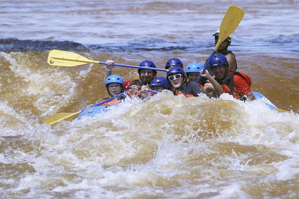 Photo - Groups travel through the whitewater rafting course at Riversport Adventures in Oklahoma City, Oklahoma on July 23, 2019. [The Oklahoman Archives]