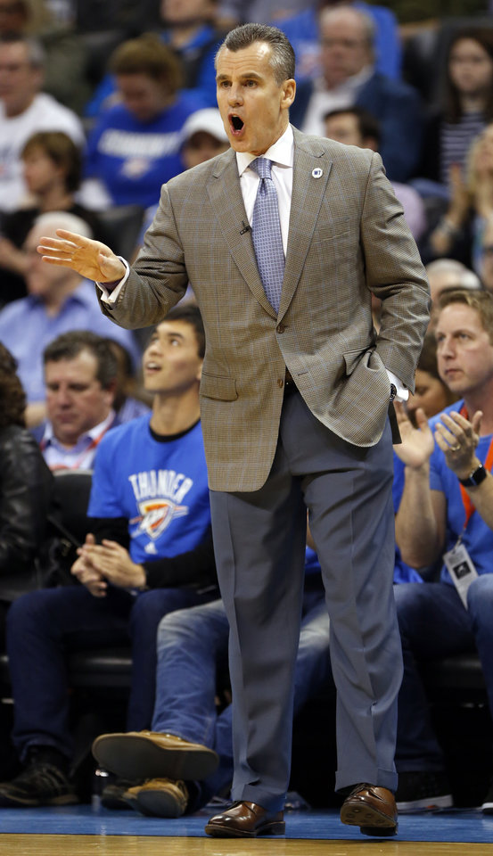 Photo - Billy Donovan reacts to play in the first half of an NBA basketball game where the Oklahoma City Thunder play the Indiana Pacers at the Chesapeake Energy Arena in Oklahoma City, on Feb. 19, 2016.  Photo by Steve Sisney The Oklahoman