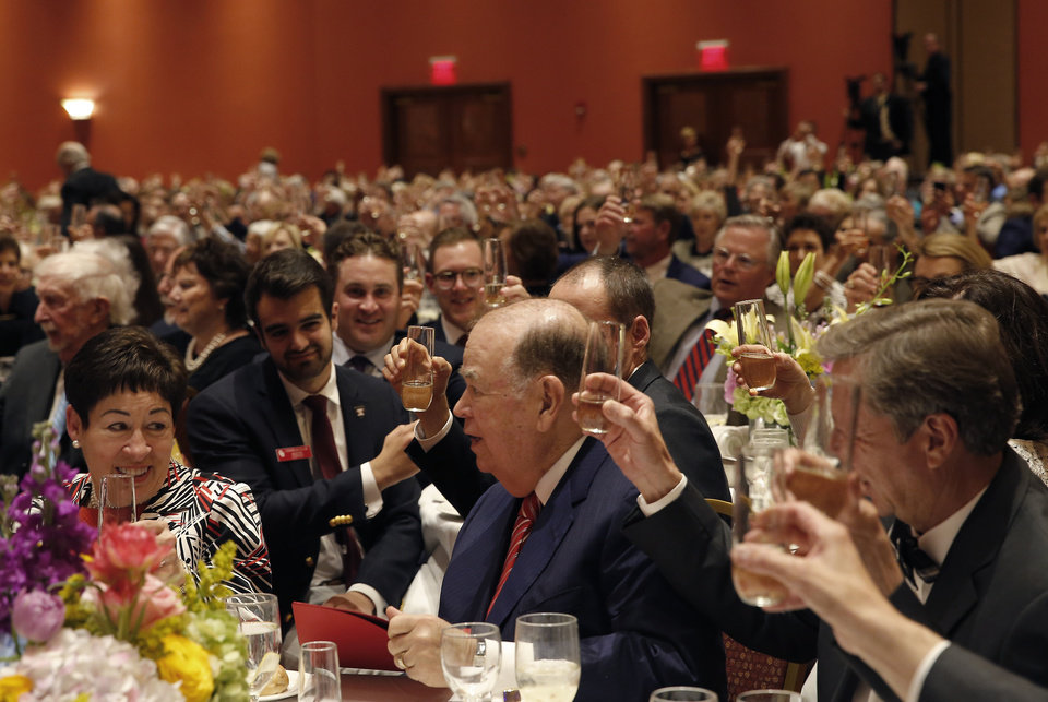 Photo - Guests toast President David L. Boren  during a dinner and reception honoring David and Molly Shi Boren in Norman, Okla., Friday, April 20, 2018. Photo by Sarah Phipps, The Oklahoman