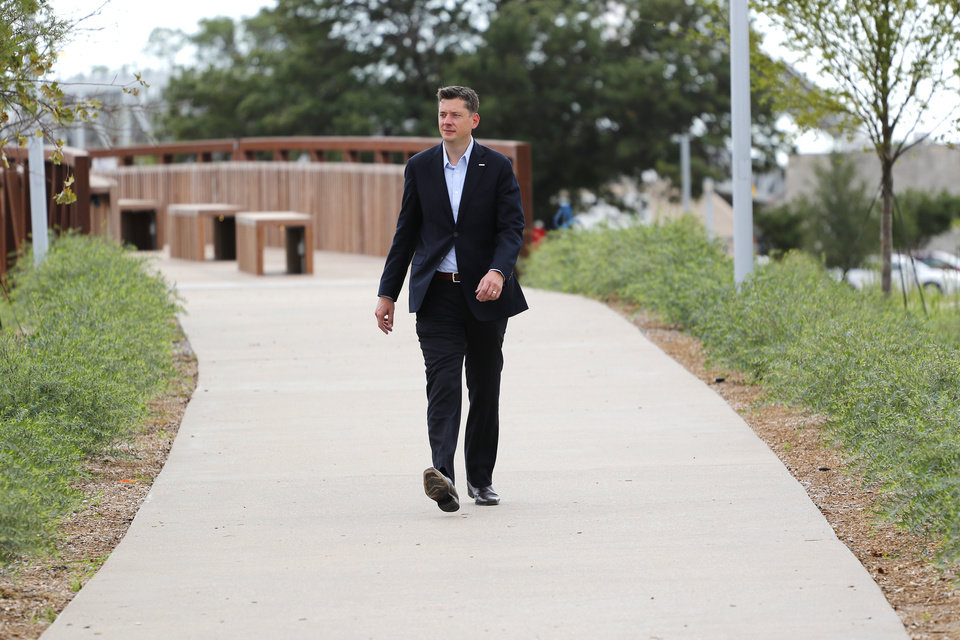 Photo -  Oklahoma City Mayor David Holt walks through Scissortail Park to meet the media. Preparations are wrapping up for the opening night Kings of Leon concert to kick off the grand opening weekend of Scissortail Park Thursday, September 26, 2019. [Doug Hoke/The Oklahoman]