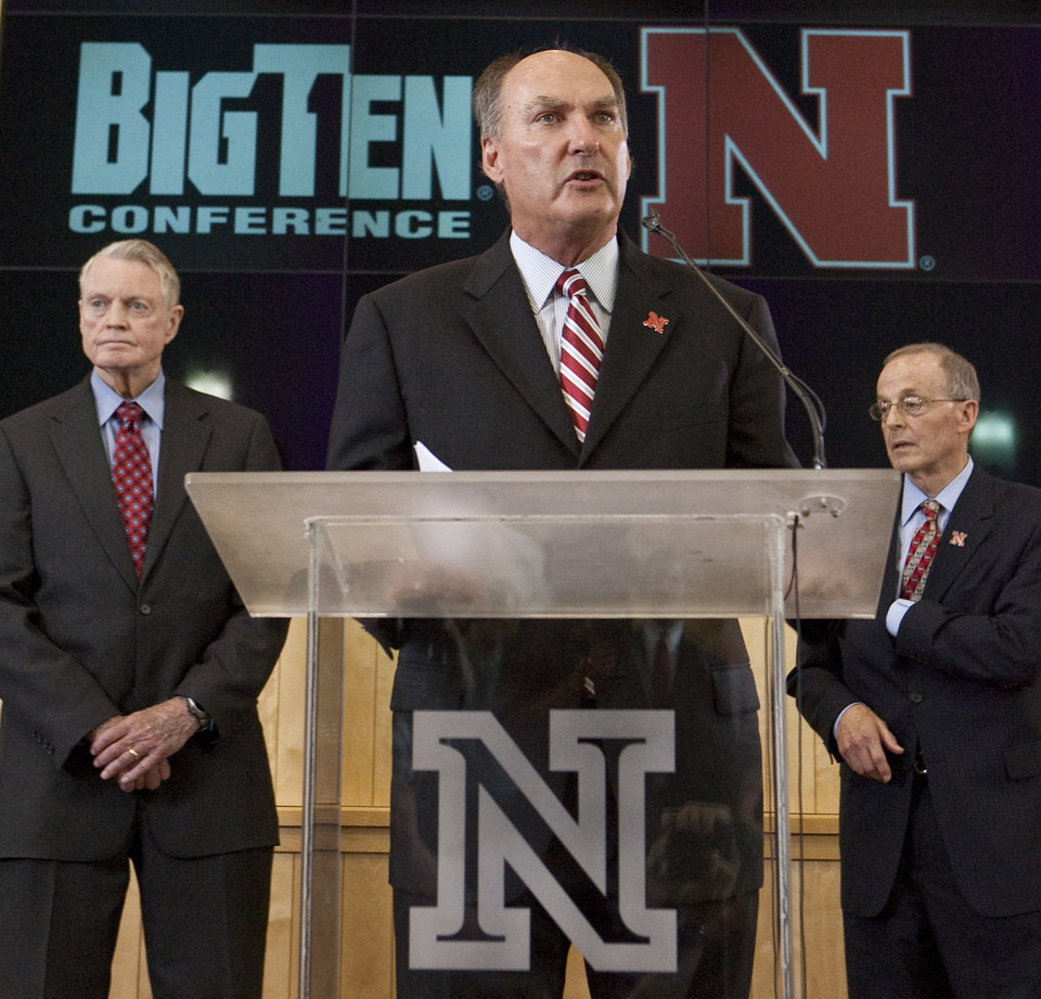 Photo - Big Ten commissioner Jim Delany, center, speaks in Lincoln, Neb., Friday, June 11, 2010, with Nebraska's athletic director Tom Osborne, left, and Nebraska chancellor Harvey Perlman, right. Nebraska made it official Friday and applied for membership in the Big Ten Conference, a potentially crippling blow to the Big 12 and the biggest move yet in an off season overhaul that will leave college sports looking much different by this time next year.(AP Photo/Nati Harnik) ORG XMIT: NENH108
