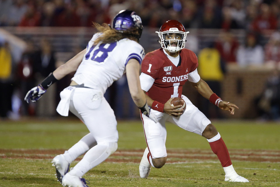 Photo - Oklahoma's Jalen Hurts (1) runs past TCU's Ben Wilson (18) during an NCAA football game between the University of Oklahoma Sooners (OU) and the TCU Horned Frogs at Gaylord Family-Oklahoma Memorial Stadium in Norman, Okla., Saturday, Nov. 23, 2019. [Bryan Terry/The Oklahoman]