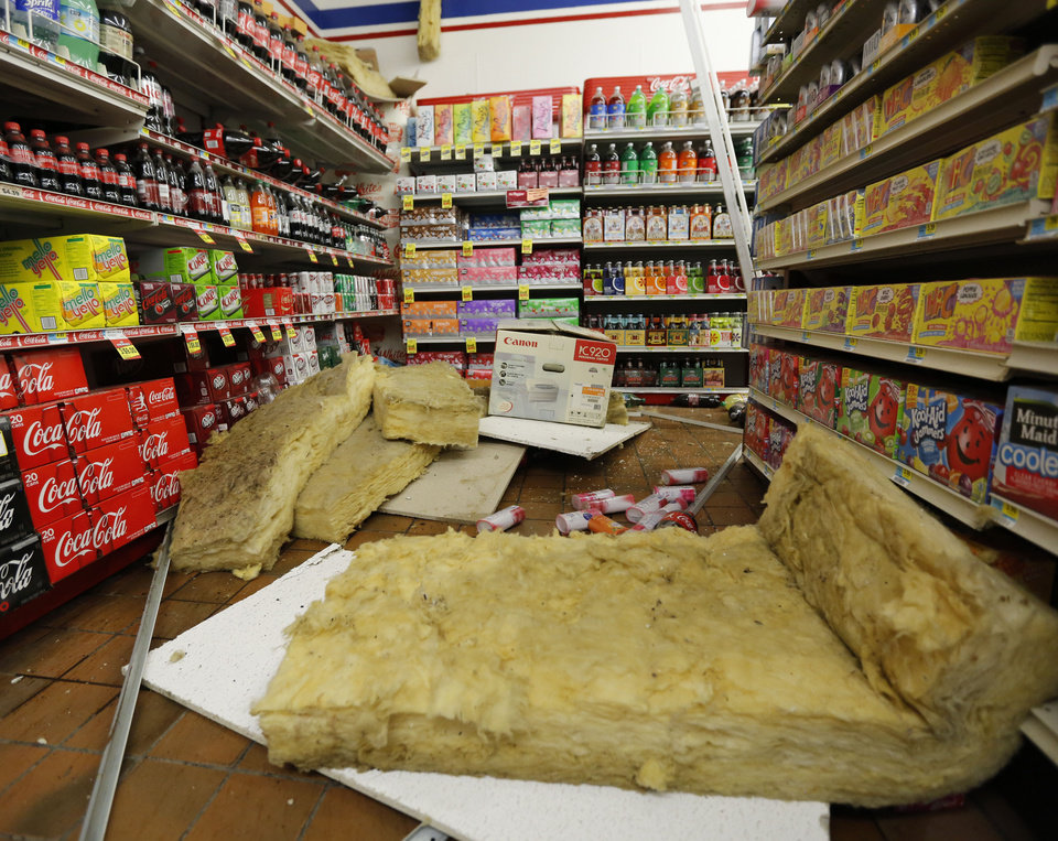 "Photo - Fallen food items and florescent lights litter the floor of ""White's Foodliner"" after an early morning 5.6 magnitude earthquake struck Pawnee, Okla. Saturday, Sept. 3, 2016.  Photo by Paul Hellstern, The Oklahoman"