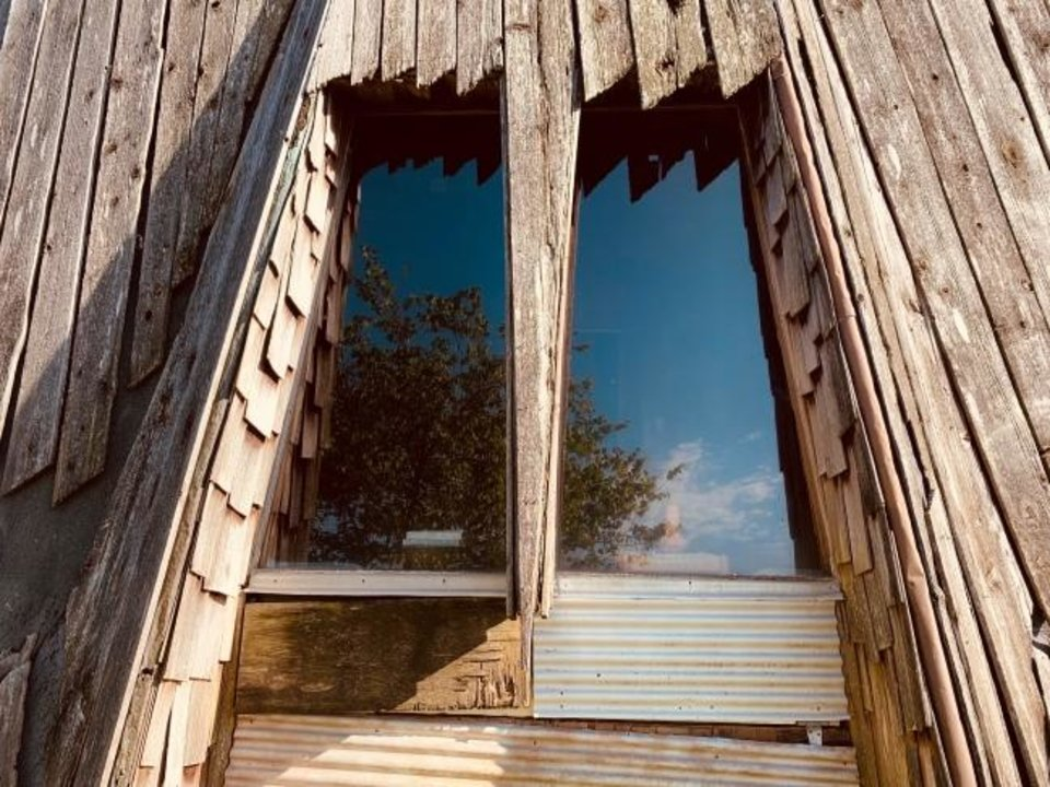 Photo -  Some of the sparse windows of the Prairie House.  [KAELEN DEESE/THE OKLAHOMAN]