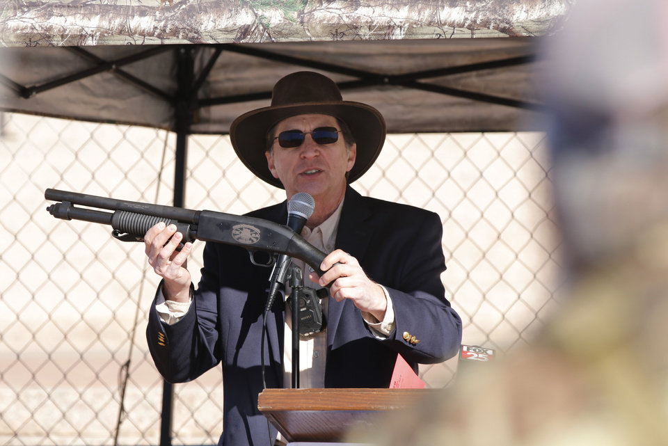 Photo - Don Spencer, president of OK2A shows off a gun that will be presented to Gov. Kevin Stitt. Second Amendment supporters rally at the state Capitol to celebrate the permitless carry law taking effect. Friday, November 1, 2019. [Doug Hoke/The Oklahoman]