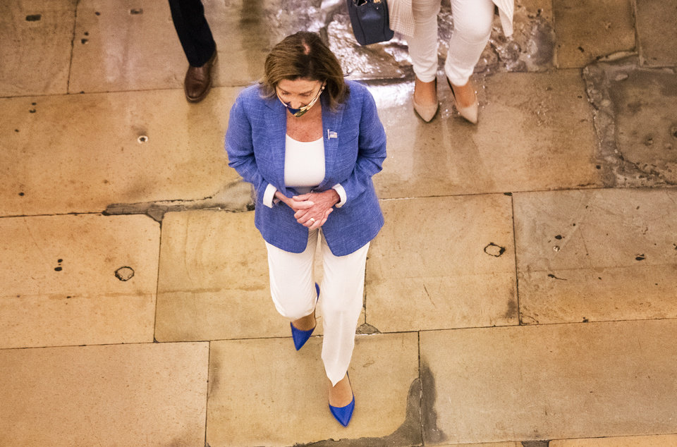 Photo -  House Speaker Nancy Pelosi walks towards her office at the Capitol to resume talks with White House chief of staff Mark Meadows and Treasury Secretary Steven Mnuchin on a COVID-19 relief bill, Saturday, Aug. 1, 2020, in Washington. (AP Photo/Manuel Balce Ceneta)