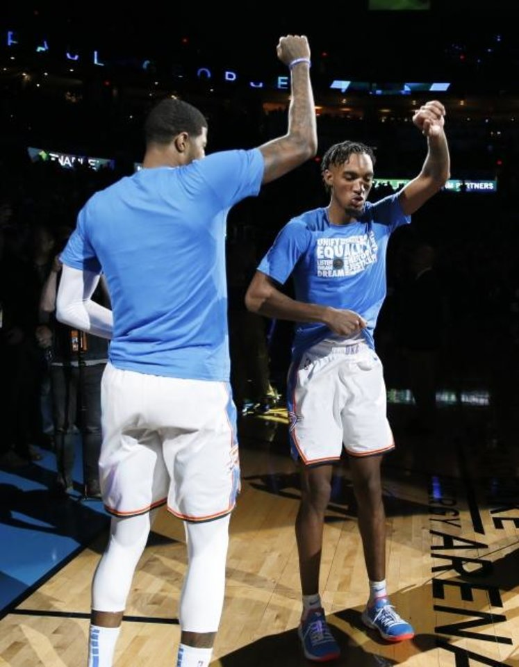Photo -  Oklahoma City's Paul George, left, and Terrance Ferguson perform part of their pregame ritual, the turkey dance, on Feb. 11. [Nate Billings/The Oklahoman]