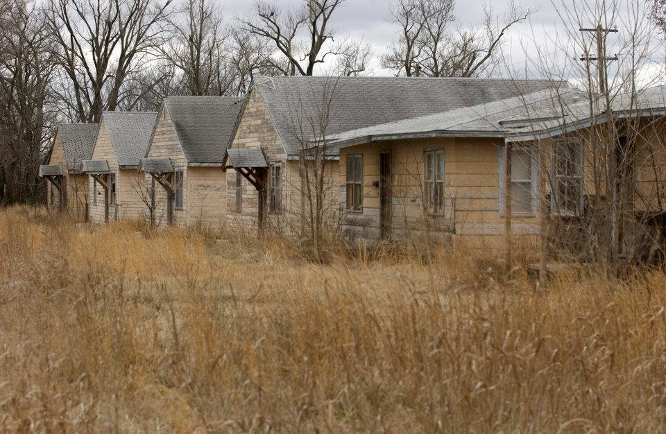 Photo -  A row of abandoned homes in Picher. [Photo by Gary Crow for the Tulsa World]