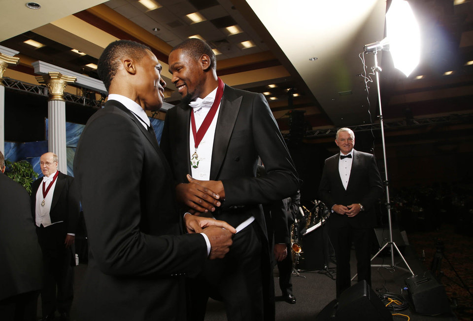 Photo - Oklahoma City Thunder basketball players Russell Westbrook (left), and Kevin Durant joke around while on stage during a photo session prior to the 8th annual Oklahoma Hall of Fame Banquet and induction ceremony, at the Renaissance Hotel in Tulsa, Okla., taken on November 19, 2015, Durant was one of the inductees. JAMES GIBBARD/Tulsa World