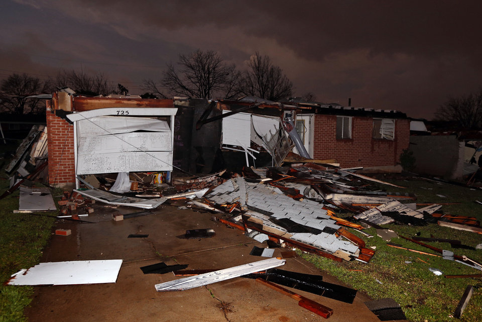 Photo - Tornado force winds blew roofs off houses on Main Street near Janeway on Wednesday, March 25, 2015 in Moore, Okla. Photo by Steve Sisney, The Oklahoman