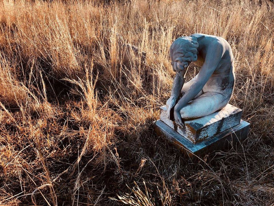 Photo - M.J. Alexander's photograph of an angel statue, captured earlier this year in an all-but-forgotten cemetery in Okfuskee County, is one of the elements of the musical and visual work