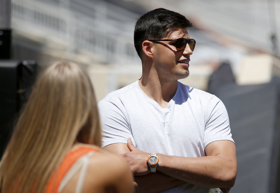 Photo - Former OSU quarterback Mason Rudolph watches the Oklahoma State Cowboys spring practice at Boone Pickens Stadium in Stillwater, Okla., Saturday, April 20, 2019.  Photo by Sarah Phipps, The Oklahoman