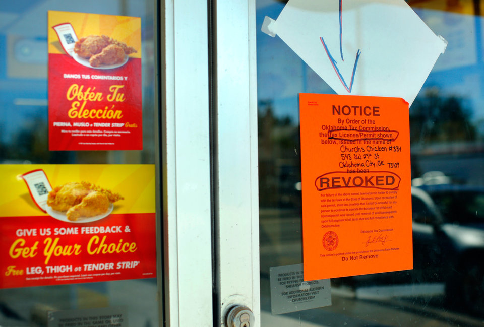 Photo -  Notice posted by order of the Oklahoma Tax Commission alerting customers that Church's Chicken in the 500 block of SW 29 remains closed on Thursday. [Photo by Jim Beckel, The Oklahoman.]
