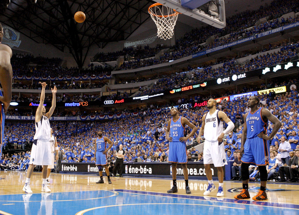 Photo - Dirk Nowitzki (41) of Dallas  shoots a free throw late in the fourth quarter of game 1 of the Western Conference Finals in the NBA basketball playoffs between the Dallas Mavericks and the Oklahoma City Thunder at American Airlines Center in Dallas, Tuesday, May 17, 2011. Photo by Bryan Terry, The Oklahoman