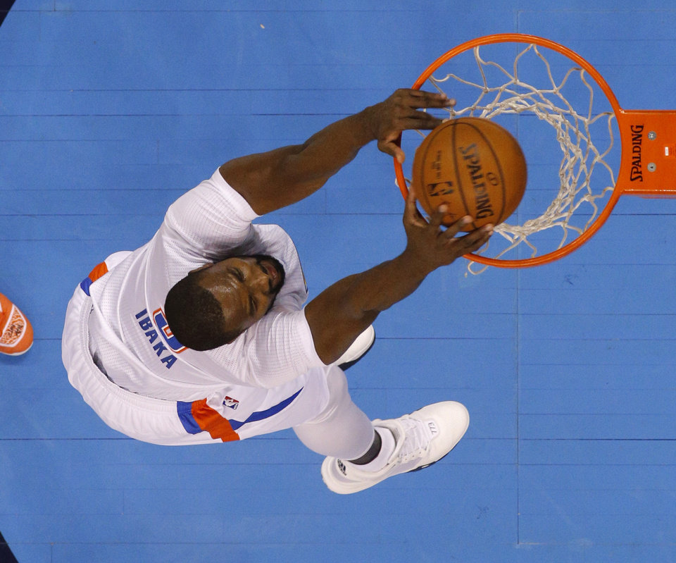 Photo - Oklahoma City's Serge Ibaka (9) dunks during an NBA basketball game between the Oklahoma City Thunder and the Houston Rockets at Chesapeake Energy Arena in Oklahoma City, Tuesday, March 22, 2016. Photo by Bryan Terry, The Oklahoman
