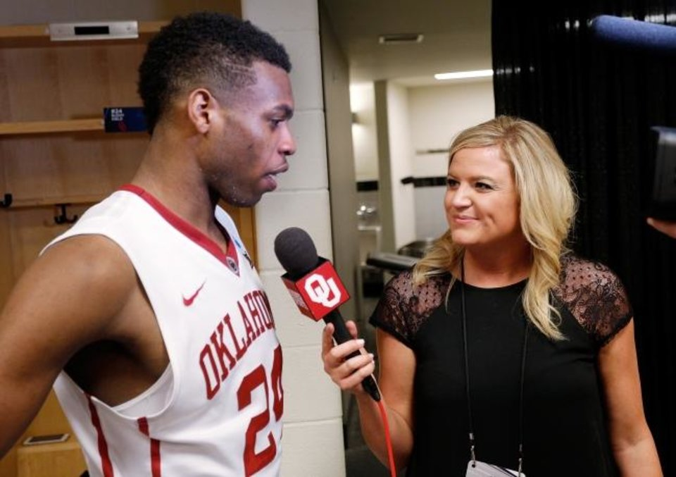 Photo -  Sooner Sports TV reporter Jessica Coody, right, interviews Buddye Hield in 2015. Coody is the FSOK play-by-play announcer for OU's game on Saturday. She is believed to be the first woman to do play-by-play for an OU men's basketball game. [Ty Russell/SoonerSports.com]