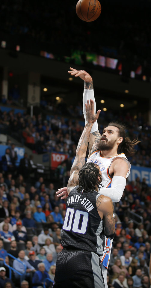 Photo - Oklahoma City's Steven Adams (12) shoots over Sacramento's Willie Cauley-Stein (00) during an NBA basketball game between the Oklahoma City Thunder and the Sacramento Kings at Chesapeake Energy Arena in Oklahoma City, Saturday, Feb. 23, 2019. Photo by Bryan Terry, The Oklahoman