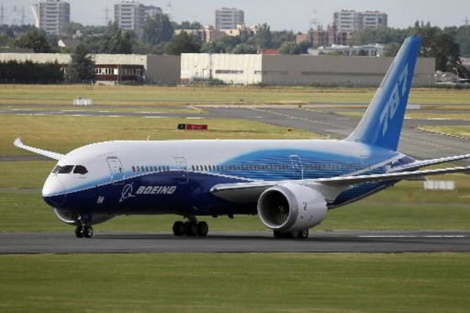 Photo - The Boeing 787 Dreamliner after its landing at Le Bourget airport upon its presentation for the first time at the 49th Paris Air Show at le Bourget airport, east of Paris, Tuesday June 21, 2011. (AP Photo/Francois Mori)