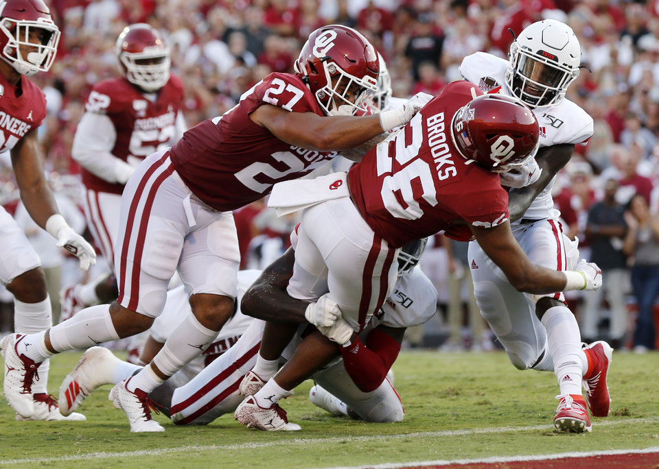 Photo - Oklahoma's Kennedy Brooks (26) scores a touchdown in front of teammate Jeremiah Hall (27) in the second quarter during a college football game between the Oklahoma Sooners (OU) and South Dakota Coyotes at Gaylord Family - Oklahoma Memorial Stadium in Norman, Okla., Saturday, Sept. 7, 2019. [Nate Billings/The Oklahoman]