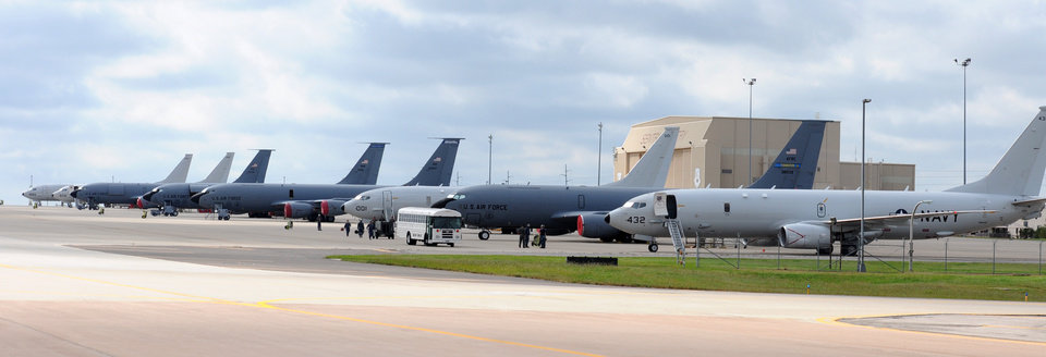 Photo -  Four Navy P-8 Poseidon aircraft from Naval Air Station Jacksonville, Florida, line up with Air Force KC-135 Stratotankers on Tinker Air Force Base's flightline Oct. 6. The P-8s, along with seven other Navy aircraft, sought shelter from Hurricane Matthew here. (Air Force photo by April McDonald)