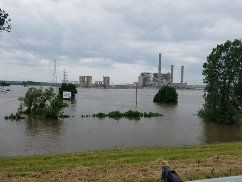 Photo -  Oklahoma Gas and Electric Co.'s Muskogee Plant is seen surrounded by water from the Arkansas River during historic flooding along the waterway in May 2019. [PROVIDED]