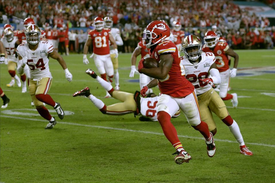 Photo - Kansas City Chiefs' Damien Williams runs toward the goal line and a touchdown against the San Francisco 49ers during the second half of the NFL Super Bowl 54 football game Sunday, Feb. 2, 2020, in Miami Gardens, Fla. (AP Photo/Matt York)