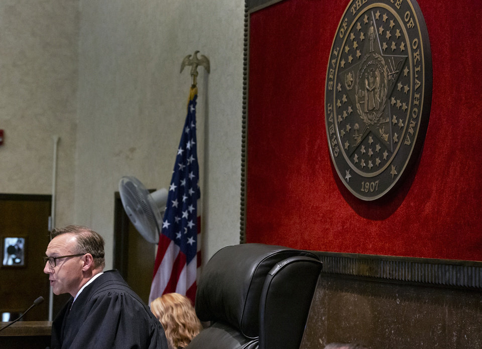 Photo - Judge Thad Balkman read a summery of his decision in  the opioid trial at the Cleveland County Courthouse in Norman, Okla. on Monday, Aug. 26, 2019. Judge Balkman ruled in favor of the State of Oklahoma, that Johnson and Johnson pay $572 million to a plan to abate the opioid crisis. The proceeding were the first public trial to emerge from roughly 2,000 U.S. lawsuits aimed at holding drug companies accountable for the nationÕs opioid crisis.  [Chris Landsberger/Pool]