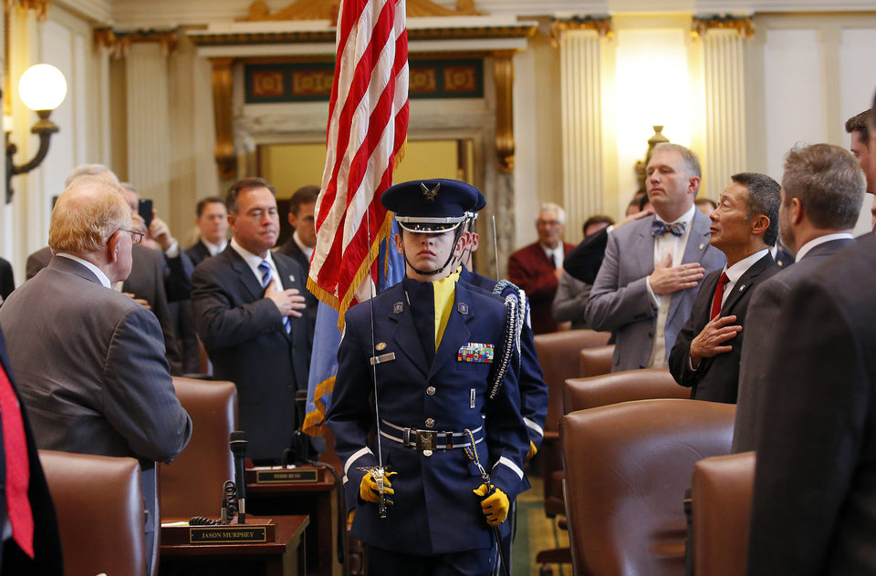 Photo - Members of Choctaw High School's  Air Force Jr. ROTC carry the American and the Oklahoma flags into the House chamber at the start of a joint session of the Oklahoma Legislature where Gov. Mary Fallin delivered her 2016 State-of-the-State address  at the Oklahoma state capitol on Monday, Feb. 1, 2016, in Oklahoma City, Okla. Photo by Jim Beckel, The Oklahoman