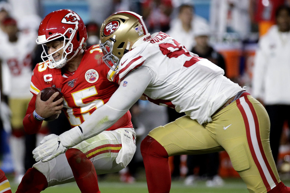 Photo - Kansas City Chiefs quarterback Patrick Mahomes (15) is sacked by San Francisco 49ers' DeForest Buckner during the second half of the NFL Super Bowl 54 football game Sunday, Feb. 2, 2020, in Miami Gardens, Fla. (AP Photo/Patrick Semansky)