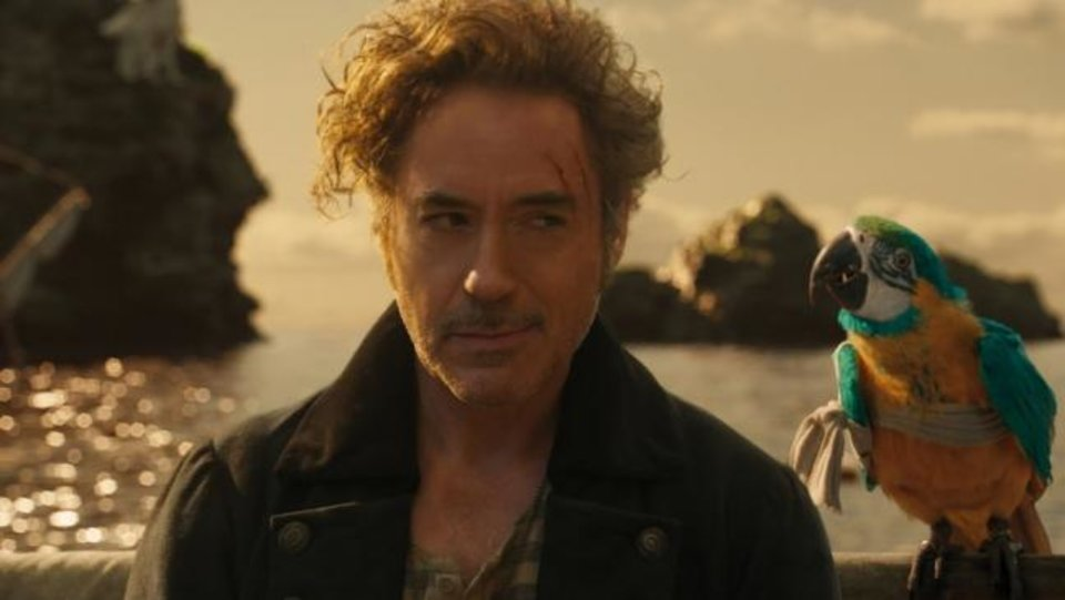 Photo -  From left, Dr. John Dolittle (Robert Downey Jr.) and parrot Polynesia (voice of Emma Thompson) appear in