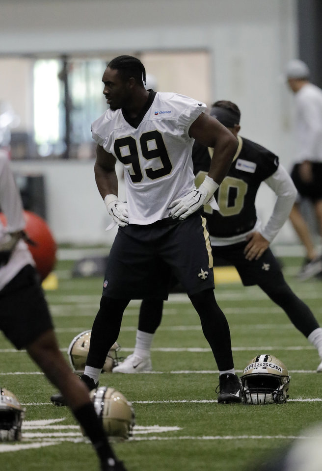 Photo - New Orleans Saints defensive lineman Geneo Grissom (99) runs through drills at their NFL football training facility in Metairie, La., Wednesday, June 12, 2019. (AP Photo/Gerald Herbert)