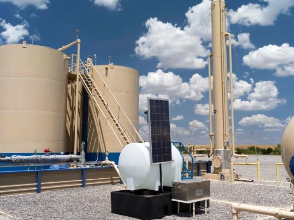 Photo -  A Devon Energy production pad in the STACK play of the Anadarko Basin is pictured. The company plans to move some dollars from the play to other basins where its oil production is better. [PROVIDED]